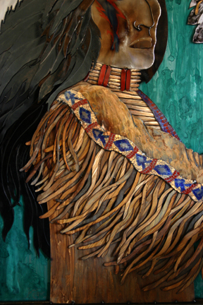 View of layered hair, breastplate and shoulder.