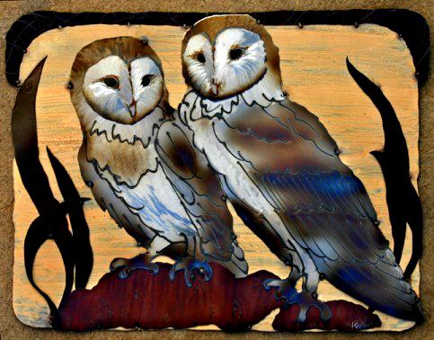 Two Barn Owlskeeping eachother warm. 21