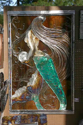 The mermaid captured so much attention, with full light to enhance her deep new patina work and new etched frame.