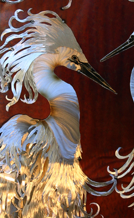 Detail of the white egret on the left with it's special head flair.